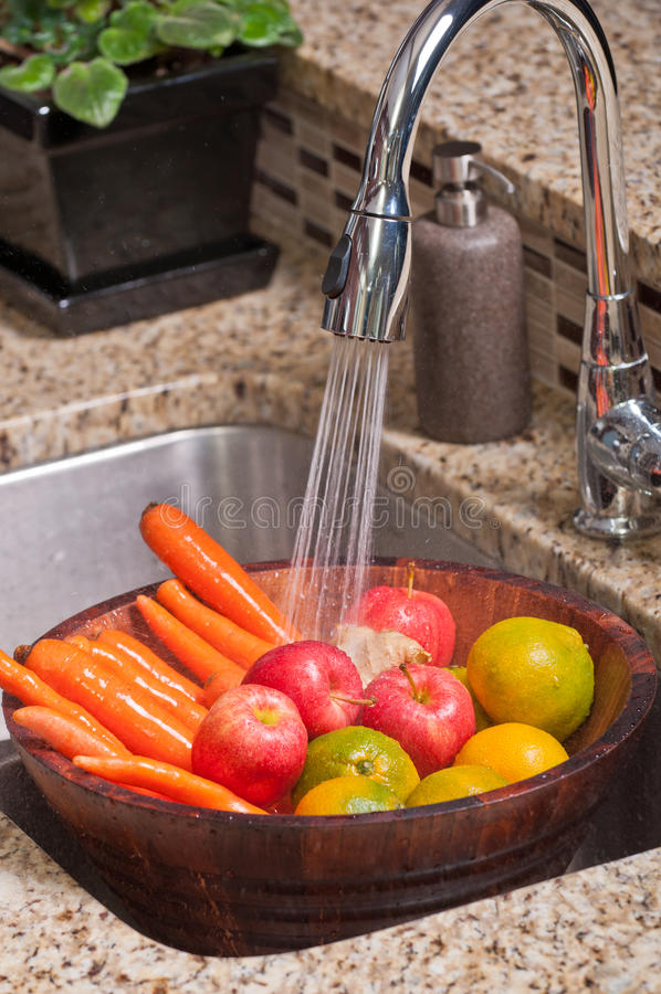 Fruits and vegetables in a modern kitchen stock image