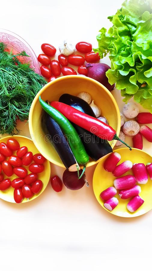 Fruits and  Vegetables Red pepper Green salat Red Tomato lilac onion garlic parsley dill radish healthy  diet stock photos