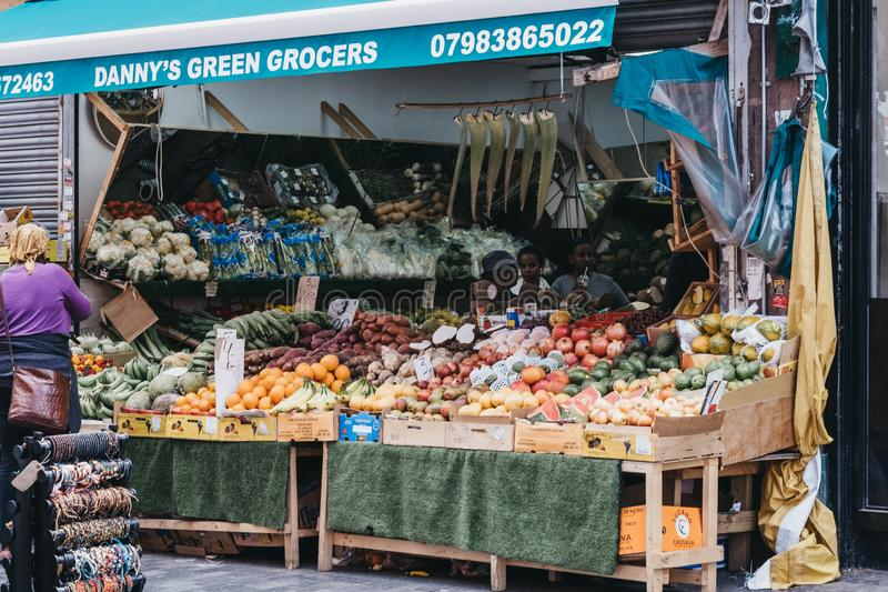 Fruits and vegetables on sale ar Danys Green Grocers at Brixton Market, London, UK stock photography