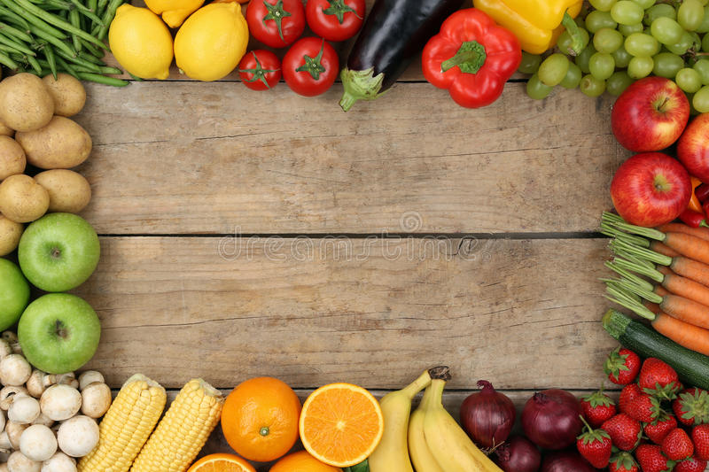 Fruits and vegetables on wooden board with copyspace royalty free stock photos