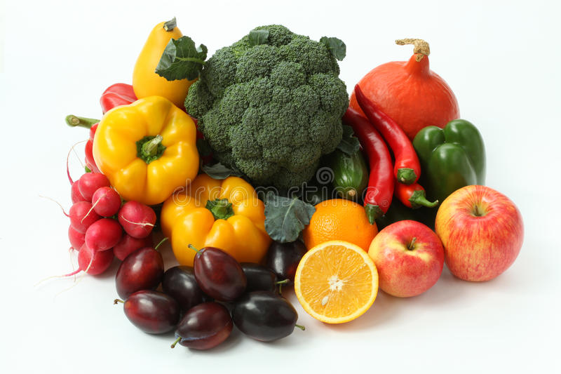 Fruits and veggies. Pile of colorful fruits and veggies on background royalty free stock photos