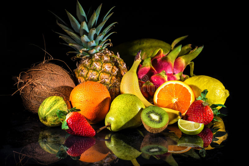 Fruits with water splash stock images