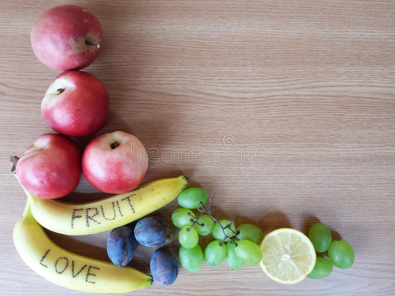 Fruits on wooden background stock image