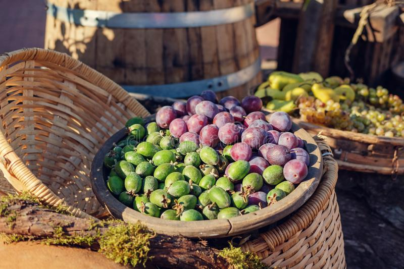 Fruits in the wooden bowl stock images