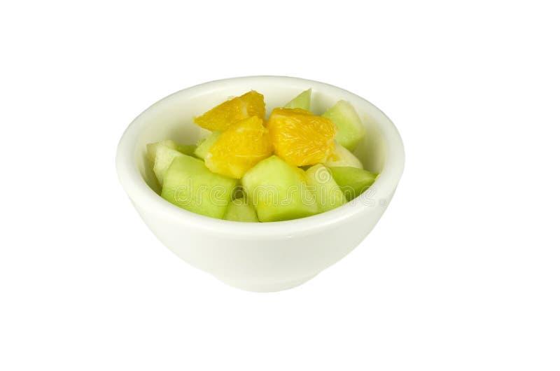 Fruitsalade in een kom. stock afbeeldingen