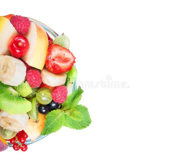 Fruitsalade in glaskom stock afbeeldingen