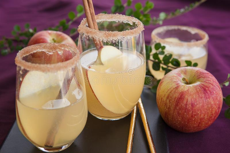 Fruity cocktail with apple stock photos