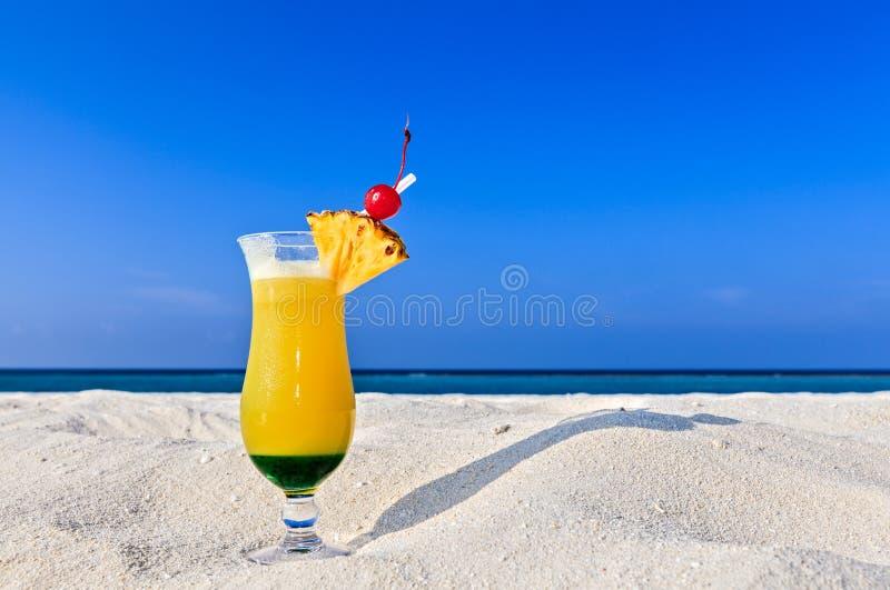 Fruity cocktail is on a beach stock photos
