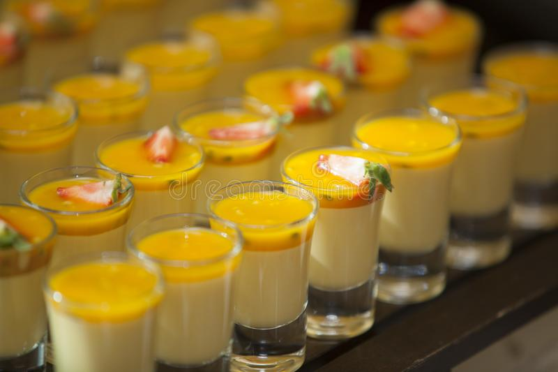 Fruity dessert cups lined up on counter stock photos