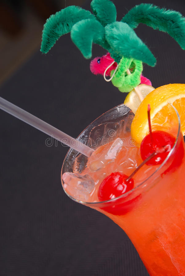 Fruity hurricane cocktail in tropical glass. stock photography