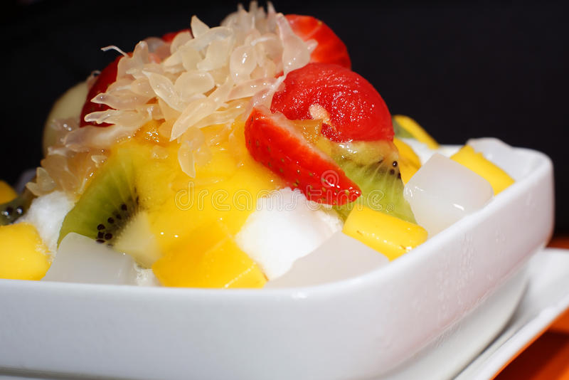 Fruity Ice. Mixed fruits on shaved ice royalty free stock photos