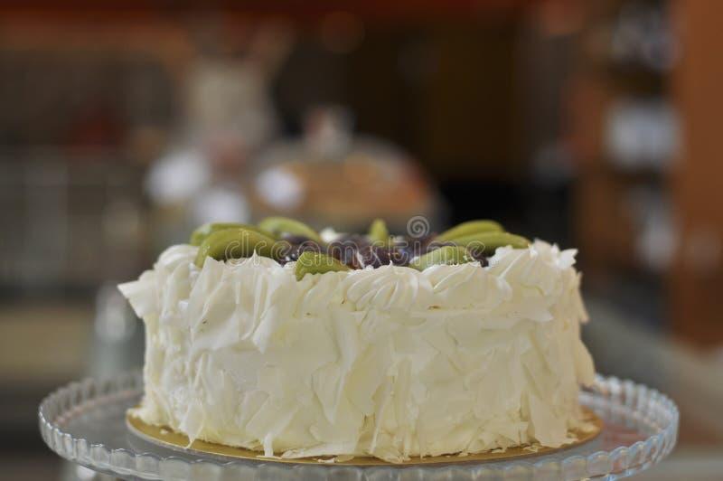 White chocolate cake with fresh fruits royalty free stock photos