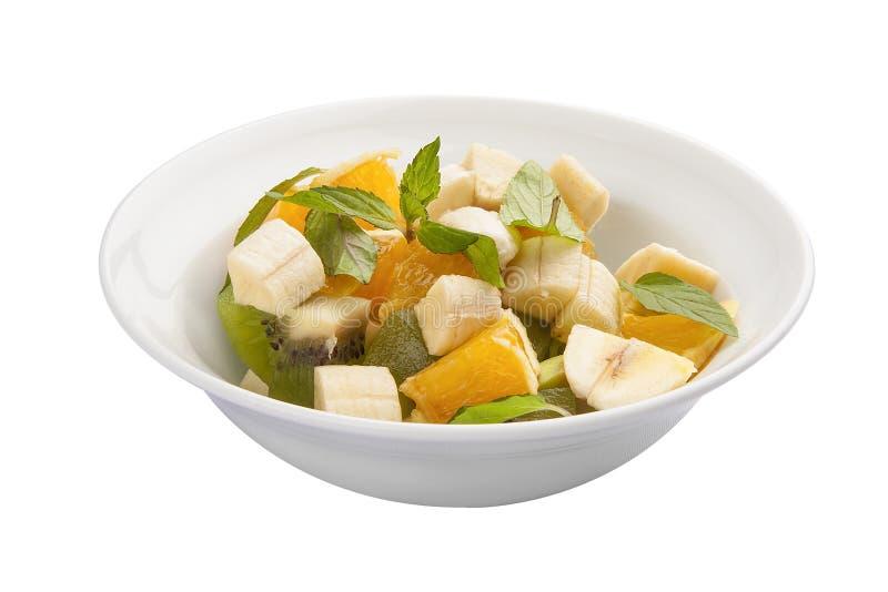 Frukostfruktsallad med bananen och avokadot arkivfoton