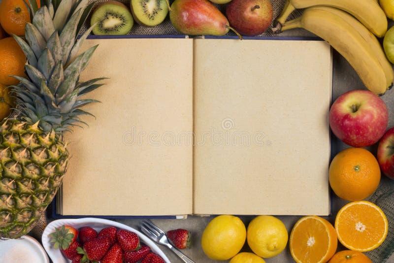 Frukt och mellanrumsreceptbok - utrymme för text arkivfoto