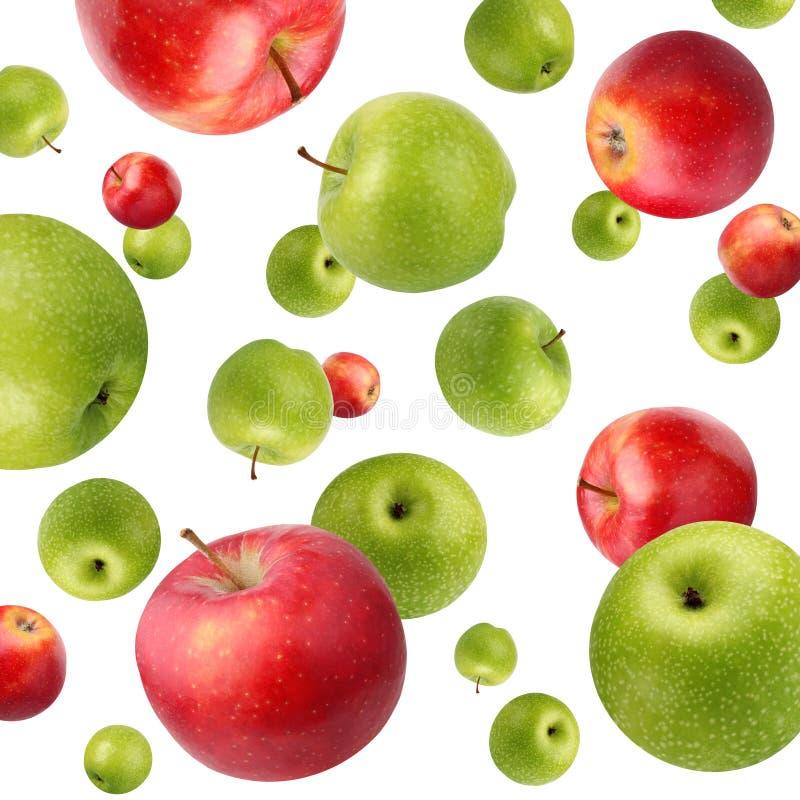 Fruktbakgrund med gröna och röda äpplen på vit arkivfoto