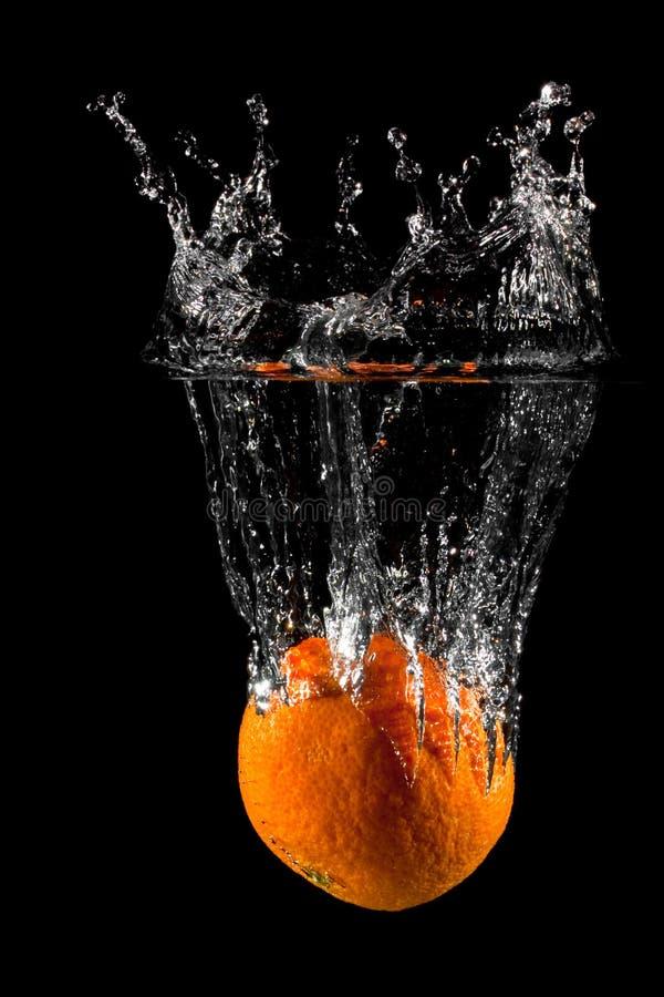 fruktorangefärgstänk royaltyfri fotografi