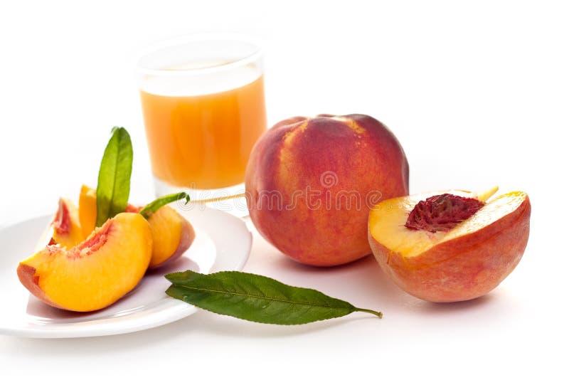 fruktsaftpersika royaltyfri bild