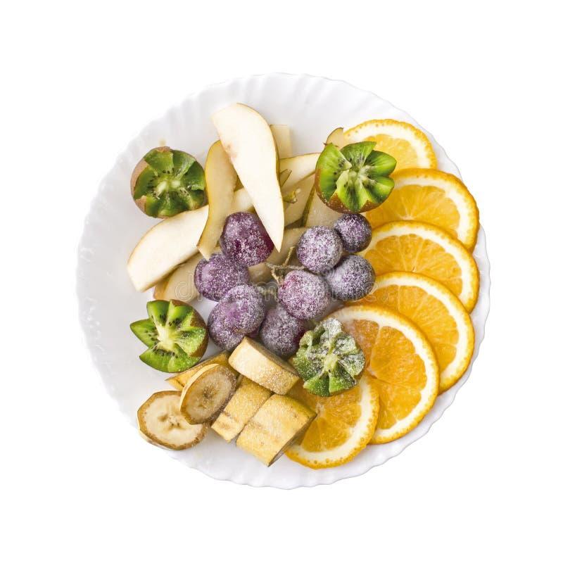 Fruktskivor apelsin, druvor, kiwi, p royaltyfri fotografi