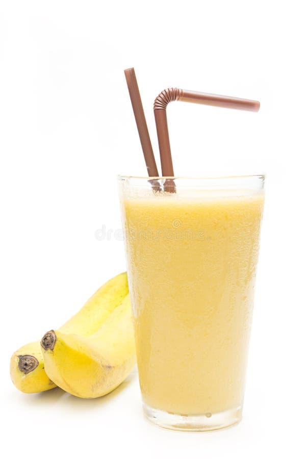 Frullato della banana in vetro fotografie stock libere da diritti