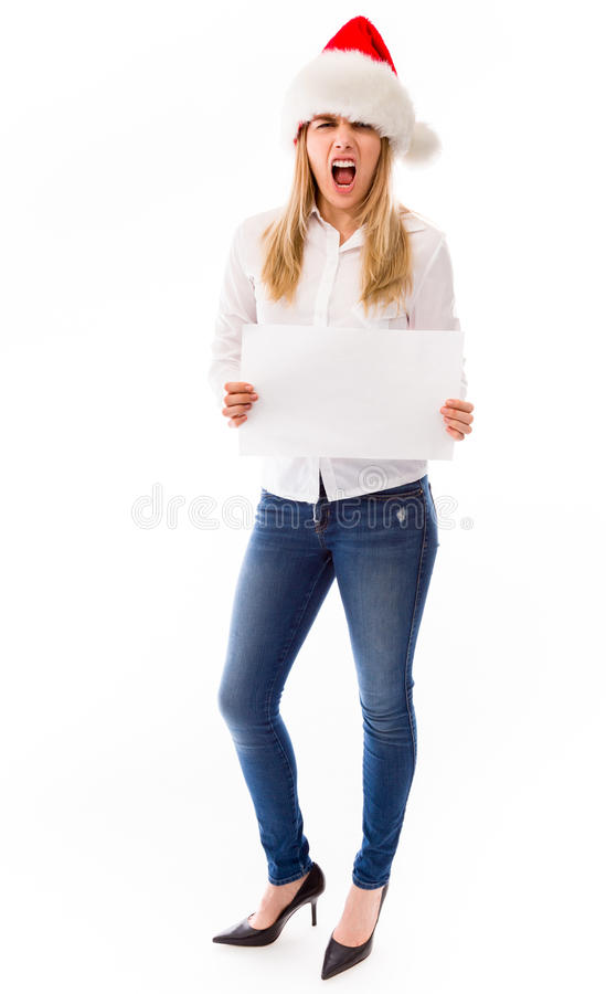 Frustated young woman showing a blank placard. Young adult caucasian woman isolated on a white background royalty free stock photography