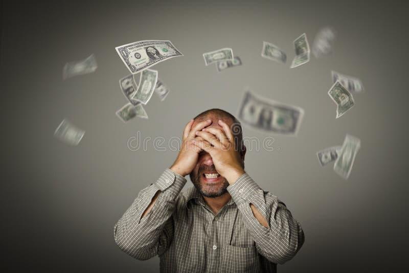 frustrado Dólares que caen fotografía de archivo libre de regalías