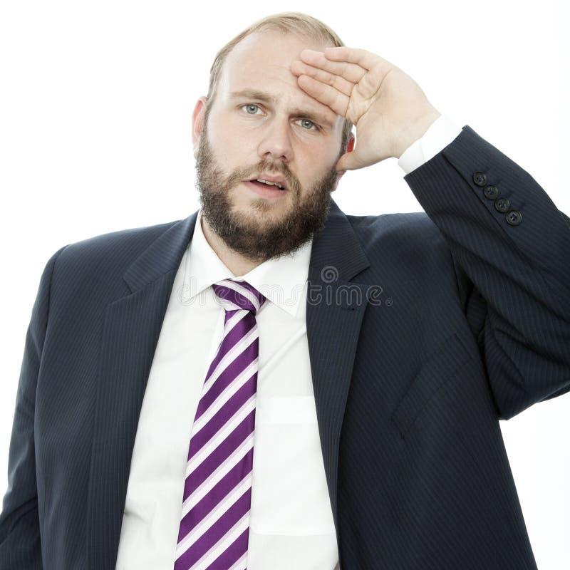 Frustran al hombre de negocios de la barba con la mano en la pista fotografía de archivo