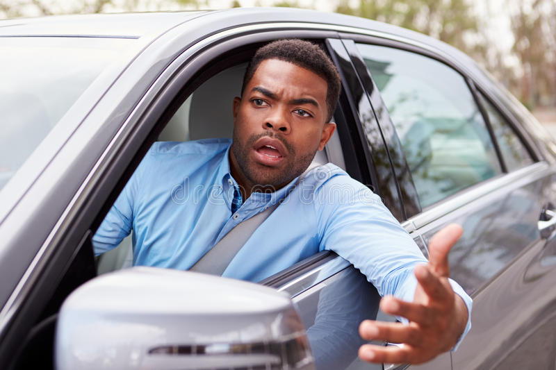 Frustrated African American male driver in car royalty free stock image