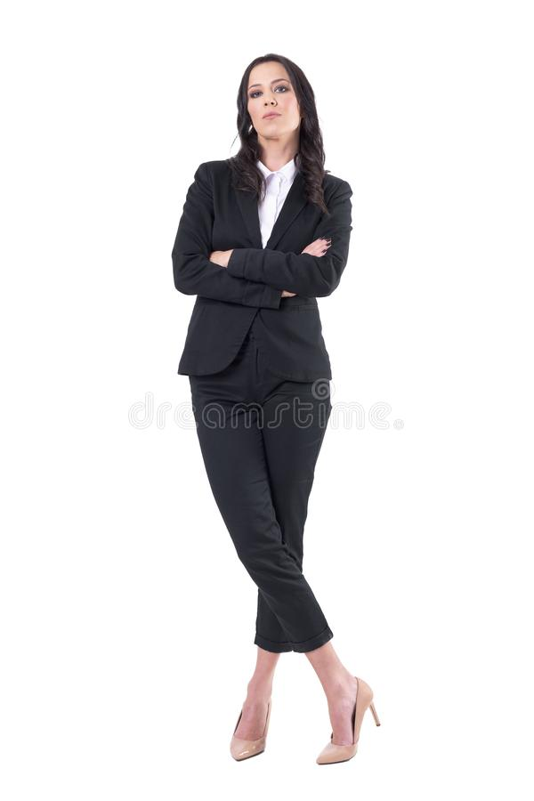 Frustrated annoyed pretty business woman ceo with crossed arms looking at camera authoritative. Full body isolated on white background stock photos