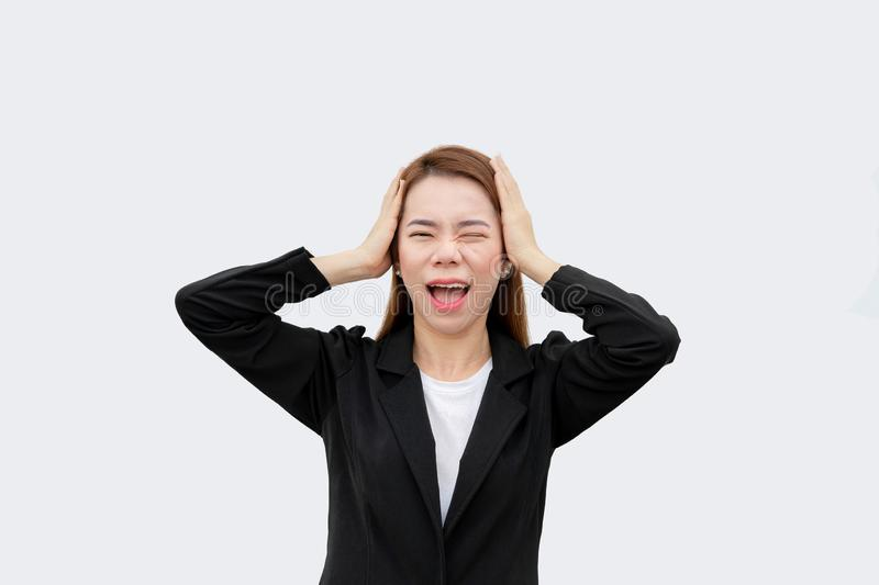 Frustrated Asian business woman screaming and put hands on head with long hair in black suit isolated on white color bakckground royalty free stock photos