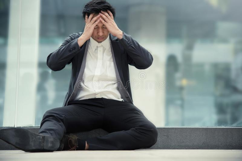 Frustrated Asian Businessman failing. About his business. Stress, tired concept stock photography