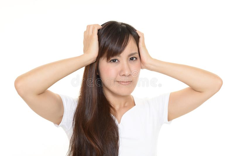 Frustrated Asian woman stock photos