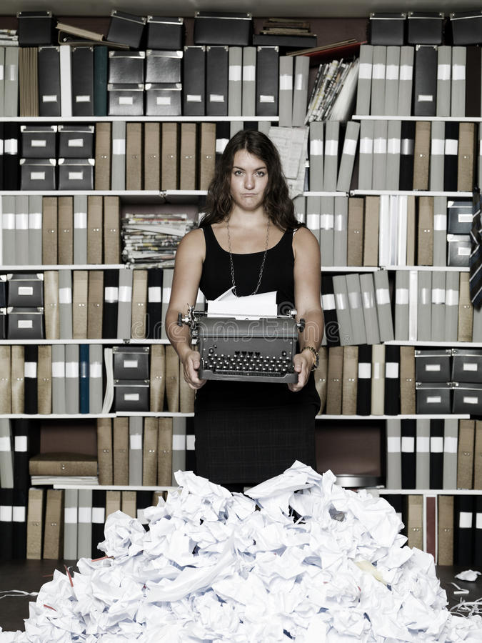 Frustrated Author. In an office with a vintage typewriter stock photo