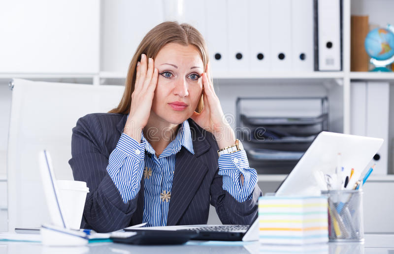 Frustrated business woman in office royalty free stock images
