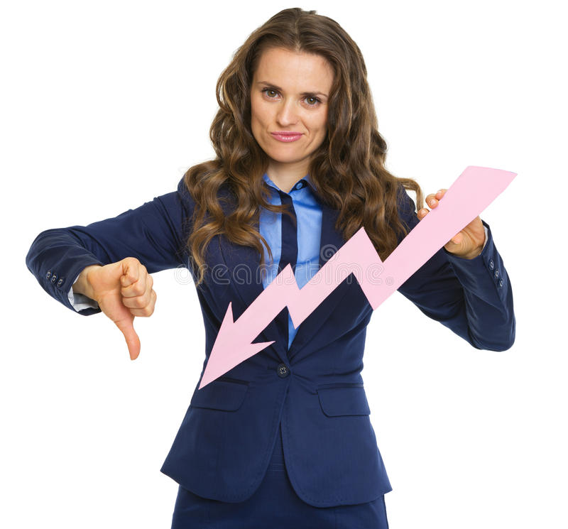 Frustrated business woman showing graph arrow going down. And thumbs down stock photo
