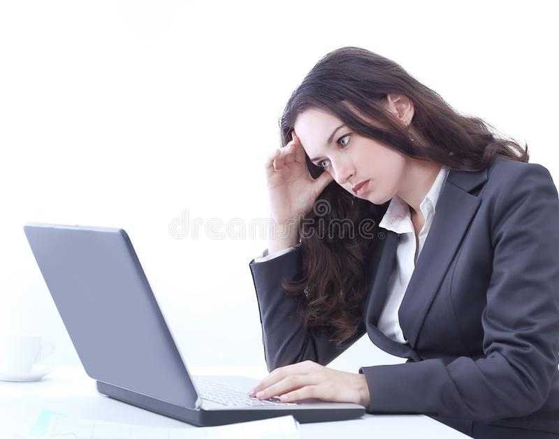 Frustrated business woman sitting in front of an open laptop royalty free stock photos