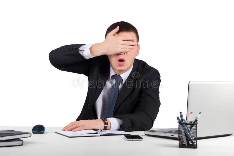 Frustrated businessman close his eyes by hand isolated on white background stock photo