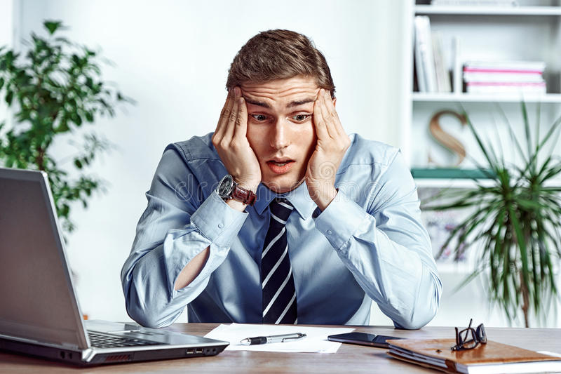 Frustrated businessman dissatisfied his earnings. royalty free stock image