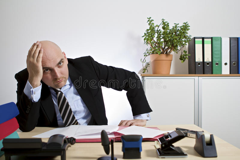 Frustrated businessman. Businessman looks frustrated and desperate in the air stock photography