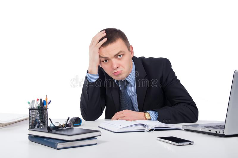 Frustrated businessman working on laptop computer at office royalty free stock photography