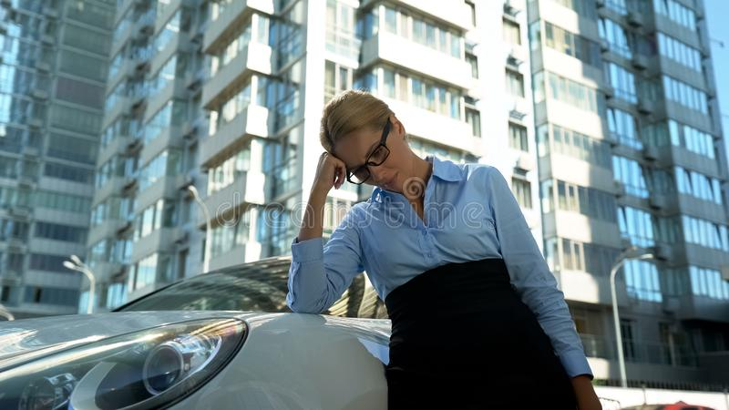Frustrated businesswoman leaning her head on hand, upset with failed startup royalty free stock photos