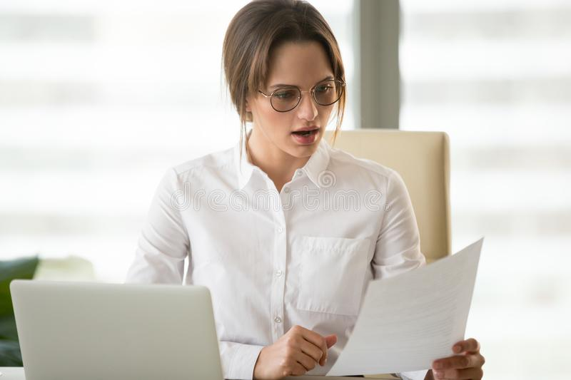 Frustrated businesswoman upset reading unsuccessful company fina stock image