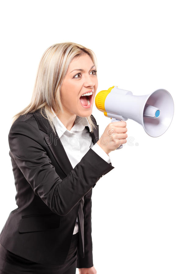 Frustrated businesswoman yelling. Through a megaphone isolated on white background royalty free stock images