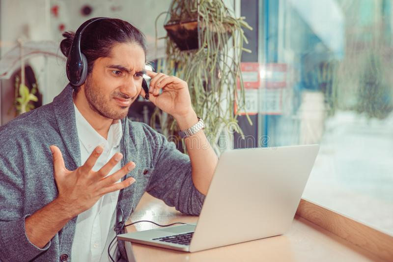 Frustrated call center employee royalty free stock image