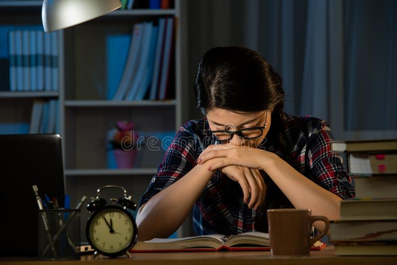 Frustrated college female studying late royalty free stock photography