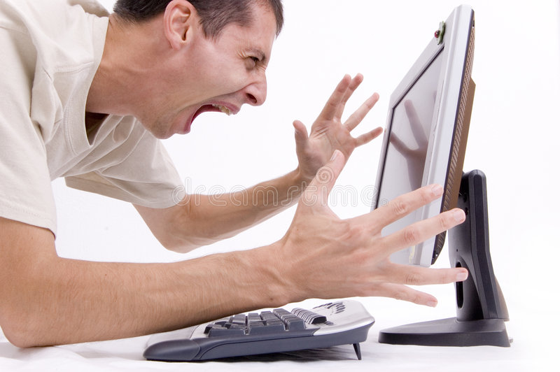 Frustrated on computer. A man screaming on computer...frustration stock photography