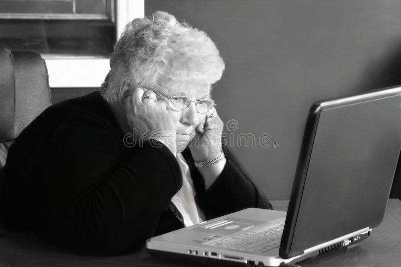 Frustrated on computers. Generations later trying to work the internet stock photos