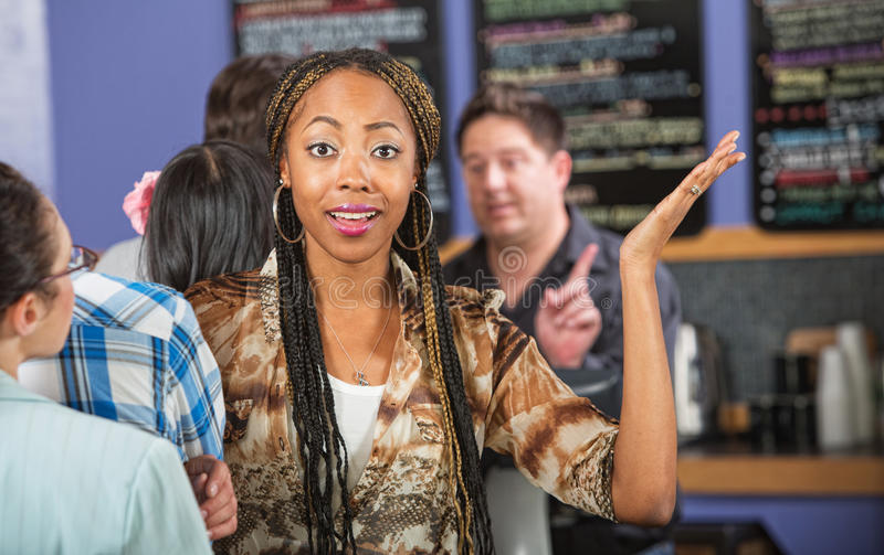 Frustrated Customer in Line. Frustrated female customer with hands up in line stock photography