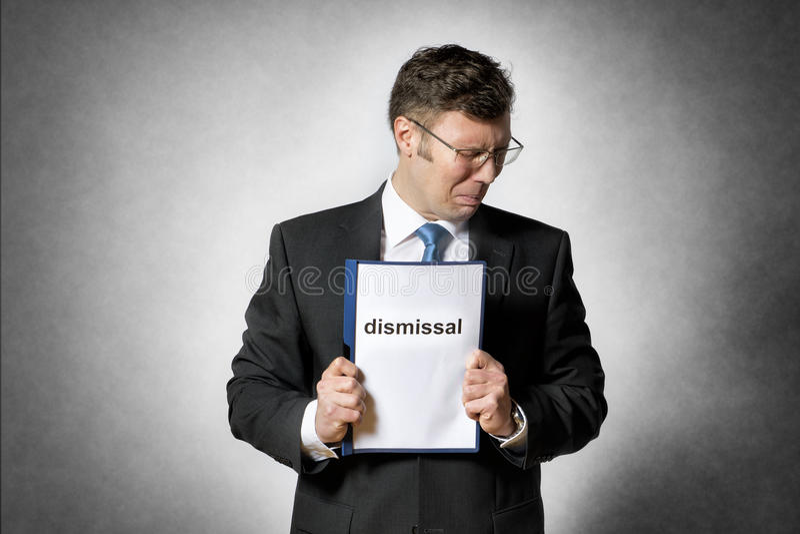 Frustrated encendió al hombre de negocios imagenes de archivo