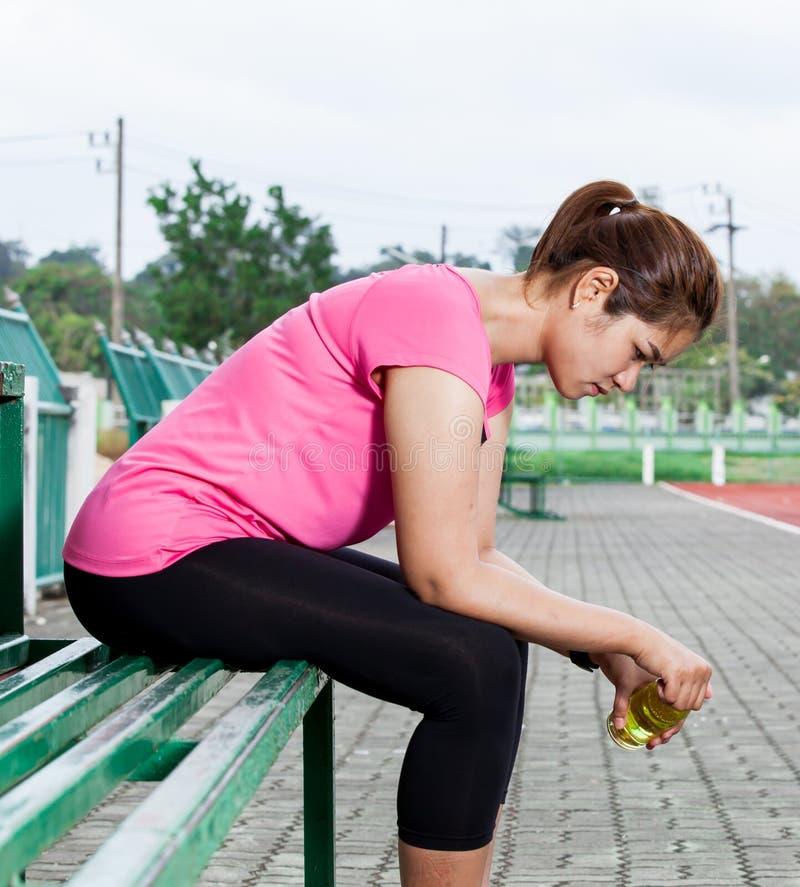 Frustrated female runner stock photo