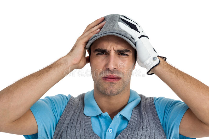 Frustrated golf player standing on white background stock photography
